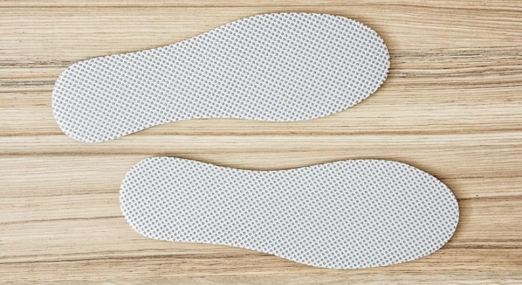 2 comfortable shoe inserts laying on table