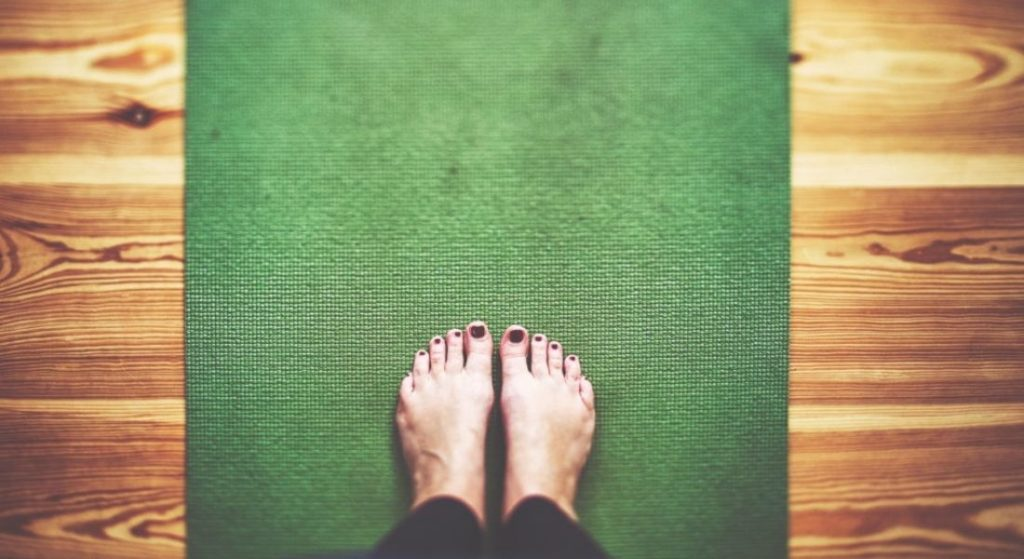 Flat feet on a green mat