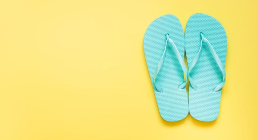 A pair of shoes with yellow background